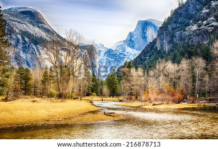 Half Dome and North Dome as seen from the Merced River below. Yosemite National Park, California. - stock photo