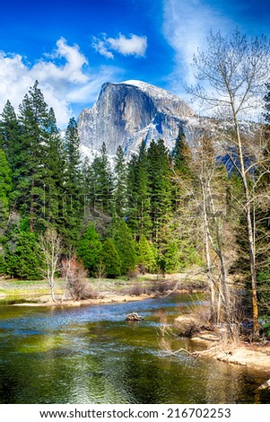 Half Dome towers above the Merced river. Yosemite National Park, California - stock photo