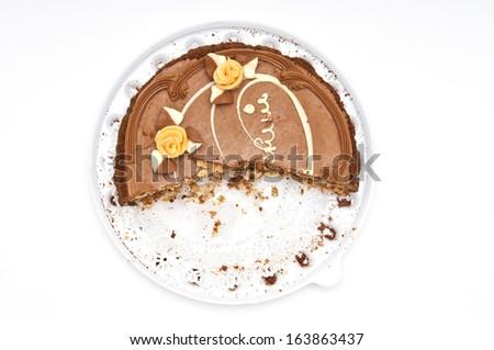 Half-eaten cake on white background - stock photo