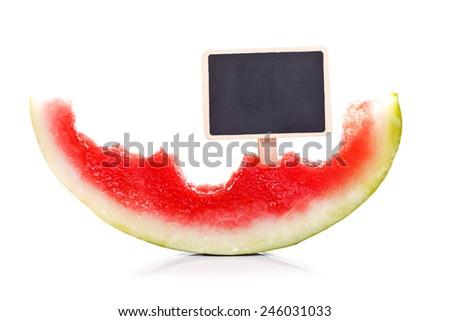Half-eaten melon with empty blackboard, concept - stock photo