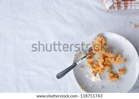 Half Eaten Slice of Orange Cake - stock photo