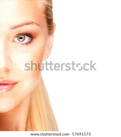 Half face of a beautiful blonde - stock photo