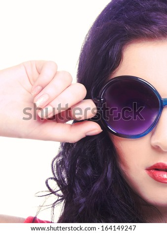 Half face of young brunette in big sunglasses. - stock photo