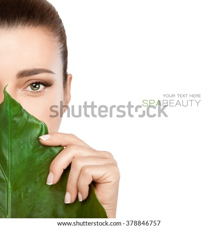 Half face woman with a fresh leaf covering mouth and nose in a spa and beauty concept. Beauty portrait isolated on white with copy space for text - stock photo