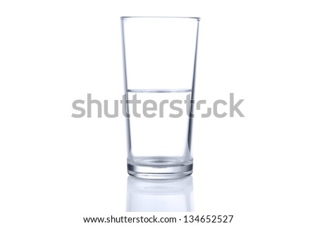 Half glass of water on white background - stock photo
