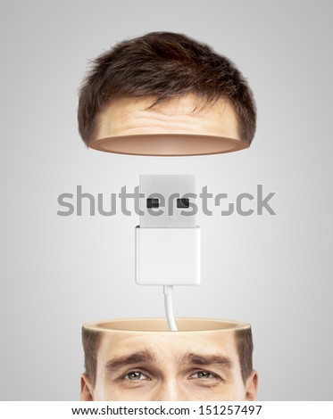 half head and usb cable on a gray background - stock photo