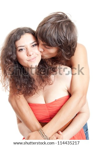 half length picture of a beautiful young couple, isolated on white - stock photo
