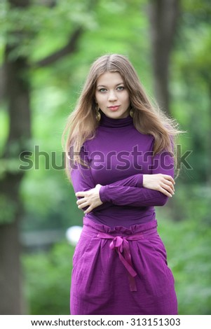 Half-length portrait beautiful girl in the park during the summer, European;White;Caucasian - stock photo