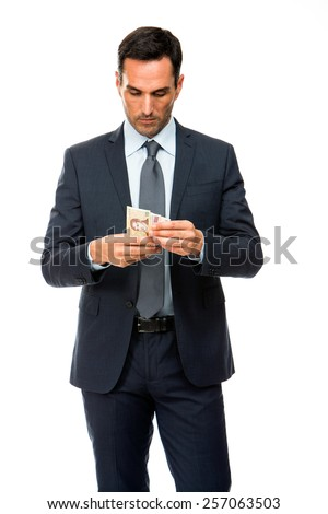Half length portrait of a businessman counting money - stock photo