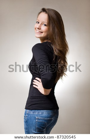 Half length portrait of a fit slender young brunette - stock photo