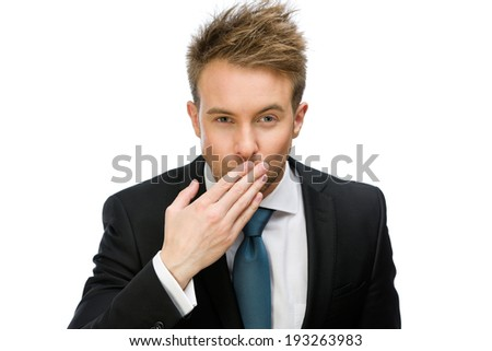 Half-length portrait of businessman blowing kiss, isolated on white. Concept of love and affection - stock photo