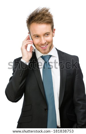 Half-length portrait of businessman speaking on cell phone, isolated on white - stock photo