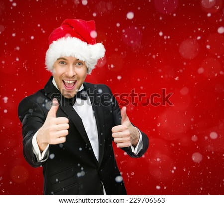 Half-length portrait of businessman wearing Santa Claus cap who thumbs up. Concept of holidays and Christmas - stock photo