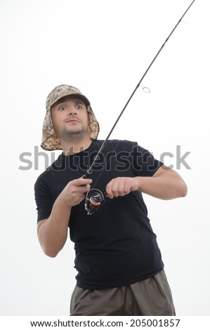 Half-length portrait of excited fisherman catching with the help of his spinner big fish. Isolated on the white background  - stock photo