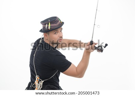 Half-length portrait of fisherman wearing nice black T-shirt and great hat throwing the spinner. Isolated on white background - stock photo