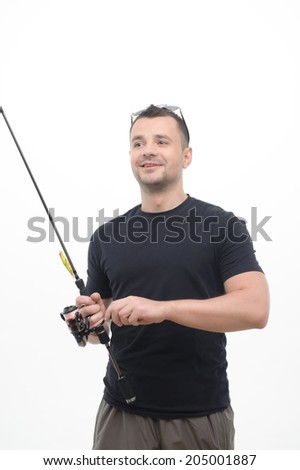 Half-length portrait of handsome smiling fisherman holding eyeglasses on his head standing with the fishing rod and looking at his friends. Isolated on white background - stock photo