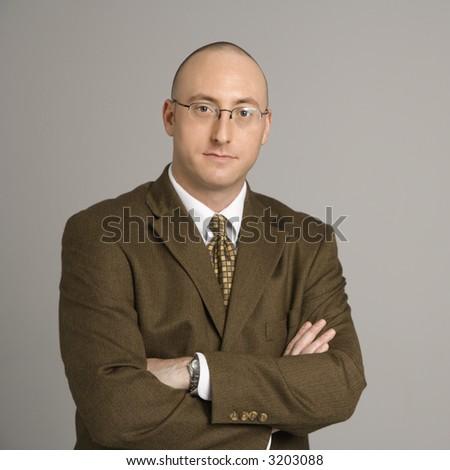 Half length portrait of mid adult Caucasian businessman. - stock photo