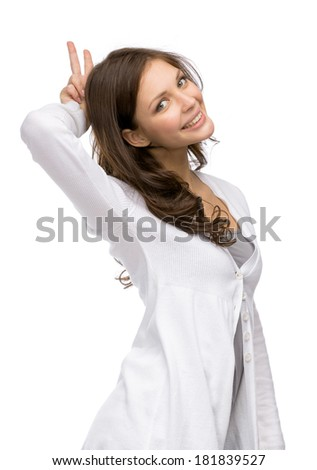 Half-length portrait of woman horns gesturing, isolated on white - stock photo