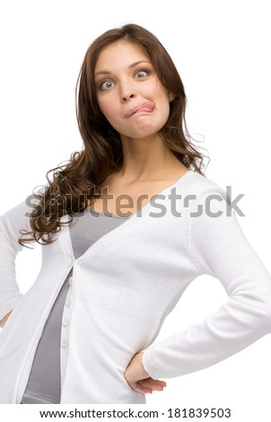 Half-length portrait of woman showing tongue, isolated on white - stock photo