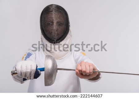 Half-length portrait of woman wearing white fencing costume and black fencing mask wanted to break her sword. Isolated on white background - stock photo