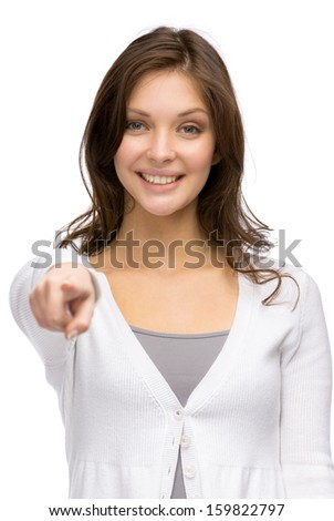 Half-length portrait of young girl pointing with hand, isolated on white - stock photo