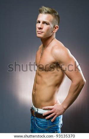 Half length profile portrait of lean fit young man. - stock photo