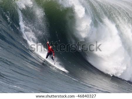 HALF MOON BAY, CA - FEBRUARY 13: Anthony Tashnick takes a spill in the 2009/2010 Mavericks Surf Contest February 13, 2010 in Half Moon Bay, California. - stock photo