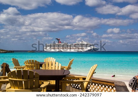 HALF MOON CAY, BAHAMAS-NOVEMBER 2: The Carnival Glory cruise ship is anchored offshore in Half Moon Cay on November 2, 2014. Half moon cay is is an island owned by cruise lines with beautiful beaches. - stock photo