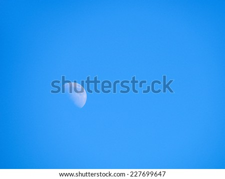 half moon in the blue sky  - stock photo