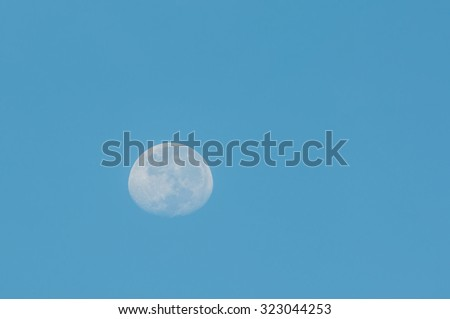 Half moon on blue sky - stock photo