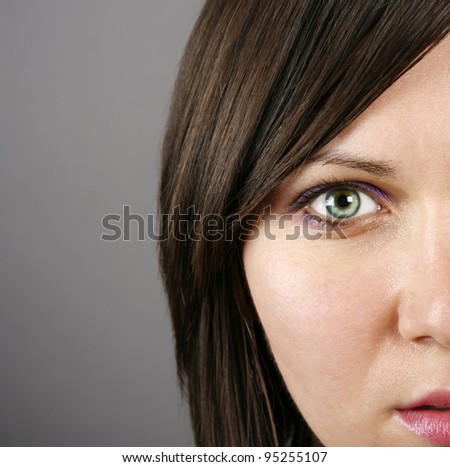 Half of a beautiful woman?s face - stock photo
