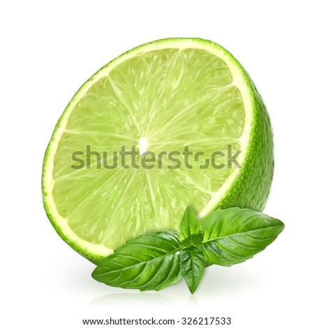 Half of lime citrus and basil sprig leaves isolated on white background including clipping path - stock photo