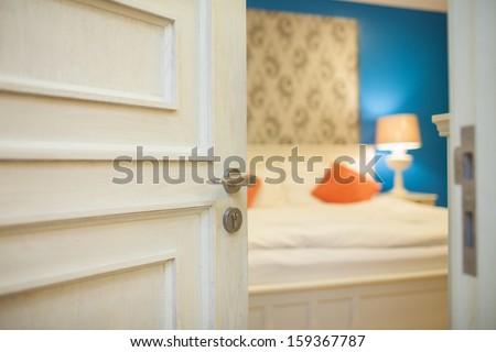 half-open door of a bedroom  - stock photo