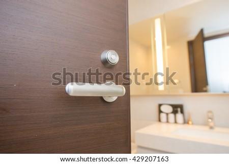 half-open door of a toilet - stock photo