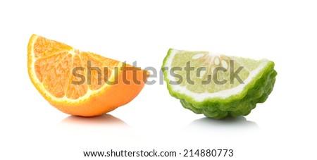Half orange fruit and bergamot white background, fresh and juicy - stock photo