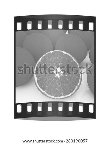 half oranges and oranges on a white background. The film strip - stock photo