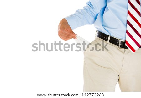 Half-portrait of man with tie, khakis, dress shirt, and belt, pulling out empty pocket, isolated on white background - stock photo