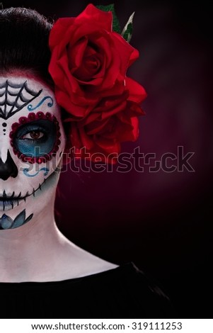 Half portrait of woman in professional makeup for halloween. - stock photo