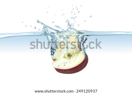 half red apple splashes into water - stock photo