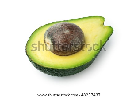 Half ripe avocado with seed isolated on white - stock photo