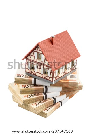 half-timbered house on euro banknotes, symbolic photograph for home purchase, financing, building society - stock photo