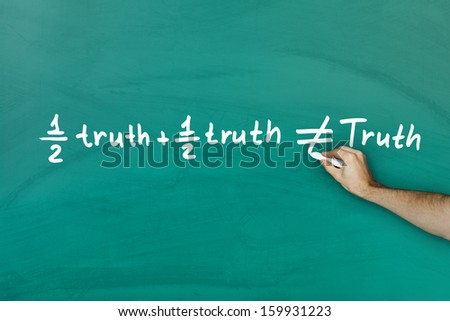 Half truth and half truth does not equal truth on green blackboard - stock photo