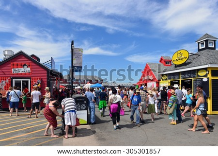 HALIFAX, CANADA - AUG 3, 2015:  The historic Halifax waterfront  contains several food stores, including Canadian food such as poutine and Beaver Tails and is a popular spot for tourists and locals - stock photo