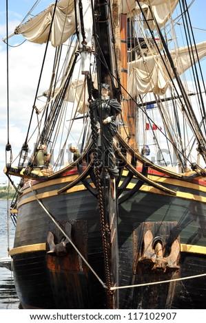 HALIFAX, CANADA - JULY 20: The front of the tall ship HMS Bounty including the figurehead.  It is a replica built in 1960 and sank in October 2012, on display July 20, 2012, in Halifax, Nova Scotia. - stock photo