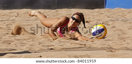 HALIFAX, CANADA - SEPTEMBER 3: Canada's Victoria Altomare dives for the ball at the FIVB Beach Volleyball Swatch Junior World Championships on Sept. 3, 2011 in Halifax, Canada. - stock photo