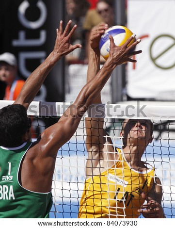 HALIFAX, CANADA - SEPTEMBER 3: Vitor Felipe of Brazil and Abolins Armands of Latvia at the FIVB Beach Volleyball Swatch Junior World Championships on Sept. 3, 2011 in Halifax, Canada. - stock photo