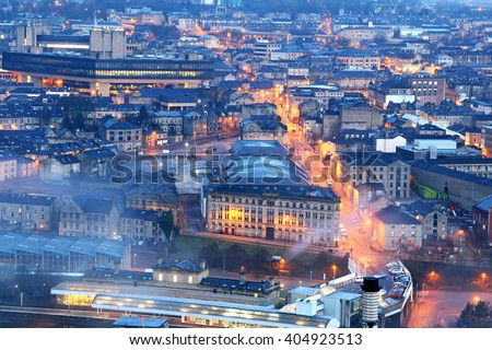 HALIFAX, UK - APRIL, 13, 2016: Aerial view of Halifax just before sunrise, West Yorkshire, UK with a low-level mist covering some of the buildings - stock photo