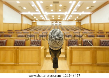 Hall government meetings. Microphone close-up on the center. - stock photo
