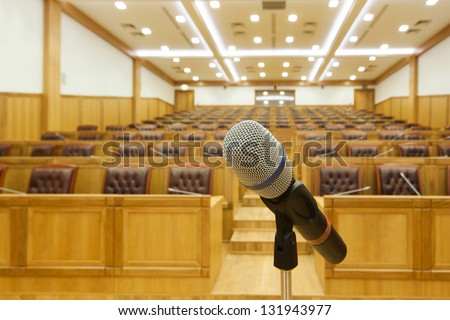 Hall government meetings. Microphone large side view - stock photo