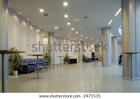 hall with little tables and armchairs for rest - stock photo